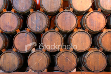ist2_1883681-stacked-wine-barrels-hz